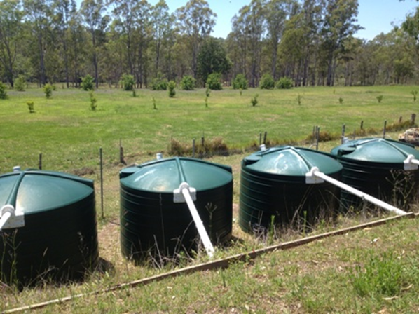 Four storage tanks for treated effluent, pasively pumped to irrigate Orchard Sewage Management system