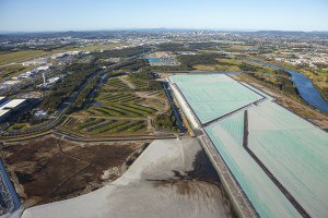 View over Brisbane Airport with rows of stored topsoil